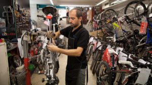 A mechanic repairs bike at Calmera bike shop in Madrid_Sept.2013